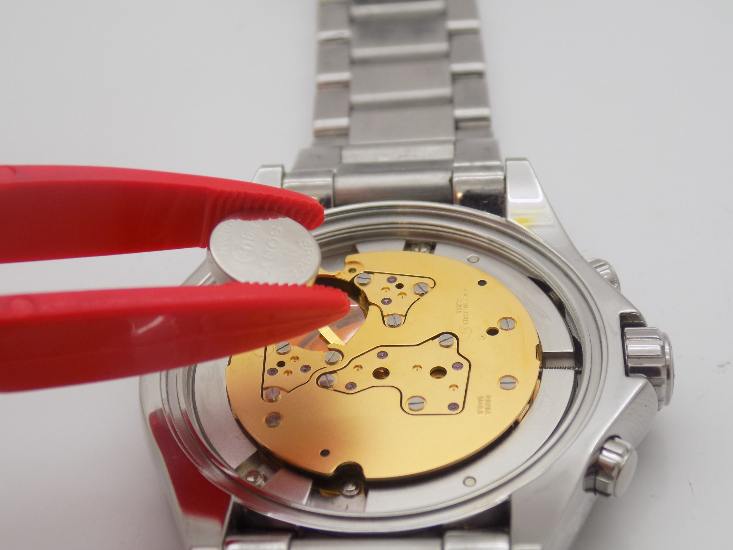 Watch battery being replaced